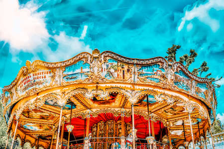PARIS, FRANCE - JULY 04, 2016 : Entertainment Carousel for the youngest children. Horses on a carnival.