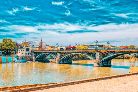 Seville, Spain- June 08, 2017 : View on downtown of Seville and Guadalquivir River Promenade. Spain. Stock Photo