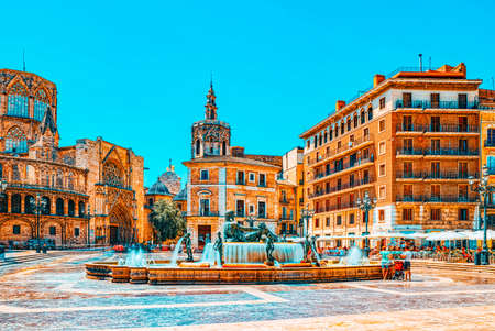 Valencia, Spain - June 13, 2017: Fountain Rio Turia on Square of the Virgin Saint Mary, Valencia Cathedral, Basilica of Virgen the Helpless. Editorial