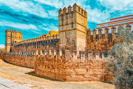Wall of Seville (Muralla almohade de Sevilla) are a series of defensive walls surrounding the Old Town of Seville. The city has been surrounded by walls since the Roman period. Stock Photo