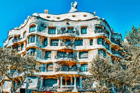 BARCELONA, SPAIN - AUGUST 28, 2008: Outdoor view Gaudi's creation-house Casa Mila. This was built between the years 1906 and 1910. In 1912, Gaudí and the Mila i Segimon marriage signed the contract of completion of the work of the Casa Mila
