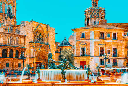 Fountain Rio Turia on Square of the Virgin Saint Mary, Valencia Cathedral, Basilica of Virgen the Helpless. Editorial