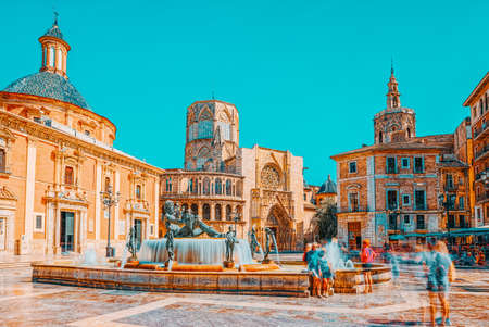 Valencia, Spain - June 13, 2017 : Fountain Rio Turia on Square of the Virgin Saint Mary, Valencia Cathedral, Basilica of Virgen the Helpless. Editorial