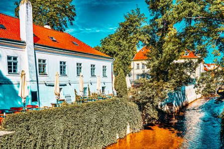 Prague's Mala Strana(Lesser Town of Prague). Ð¡ozy streets with cafes on the river side.Czech Republic.