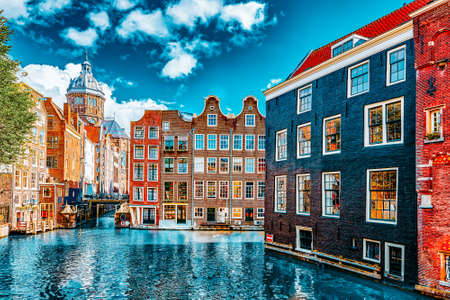 """Beautiful views of the streets, ancient buildings, people, embankments of Amsterdam - also call """"Venice in the North"""". Netherland"""