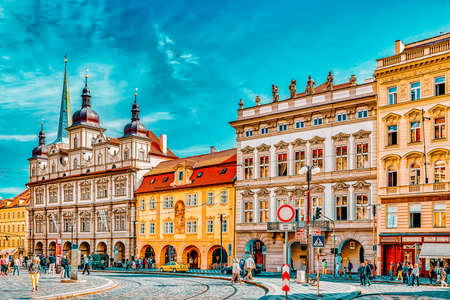 PRAGUE, CZECH REPUBLIC-SEPTEMBER 5, 2015: Malostranske namesti-main square of Prague's Mala Strana(Lesser Town of Prague). St. Nicholas Church and the adjacent building complex divides the square in an upper and lower part.Czech Republic.