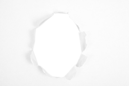 gash: Round hole in paper with white background inside