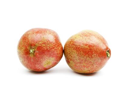pomegranat: red sliced pomegranate on a white background