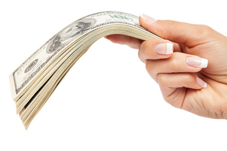 us money: Many dollars falling on womans hand with money