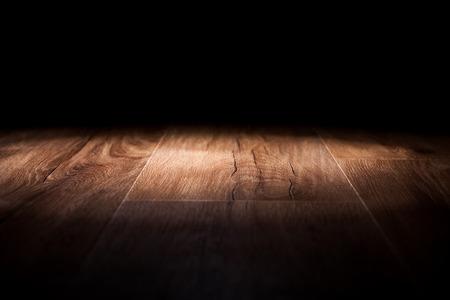 industry moody: Light on wooden floor in empty room