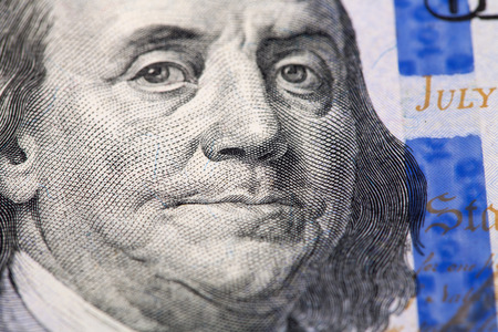 ben franklin money: face of Franklin on the account of dollar macro
