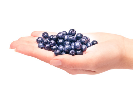 handful: Handful of blueberries on white background Stock Photo