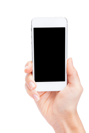 Hand holding White Smartphone with blank screen on white background Banque d'images