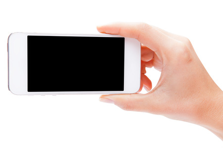 Hand holding White Smartphone with blank screen on white background Фото со стока