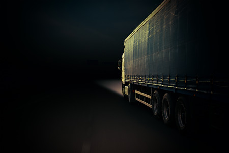 highway night: Semi Truck In Motion. Speeding Truck on the Highway Stock Photo