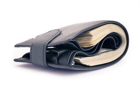 Un bolso negro con el paquete grande de dólares Foto de archivo - 42561057