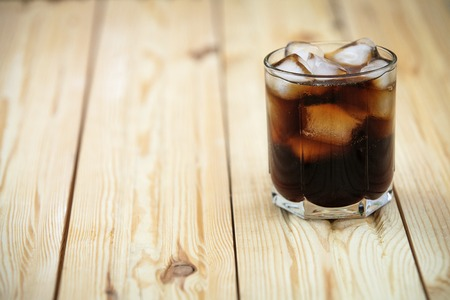 carbonation: soft drink on a wooden background