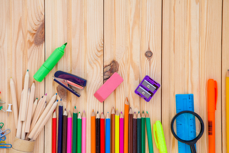objects: school objects isolated on a wooden background