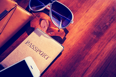 passports: objects for travel isolated on a wooden background