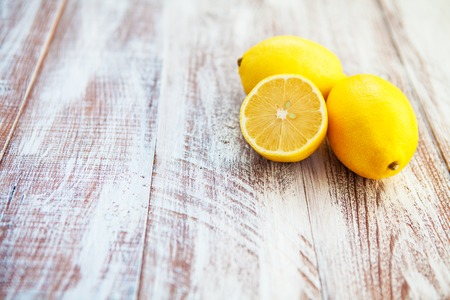 lemon isolated on a wooden background