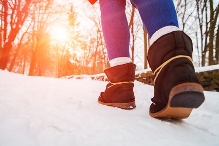 walk of girl in boots on snow