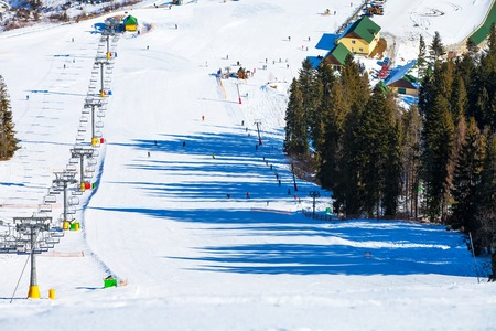 chairlift: Chairs on chairlift ropeway in winter mountains Stock Photo