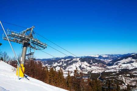 ropeway: Chairs on chairlift ropeway in winter mountains Stock Photo