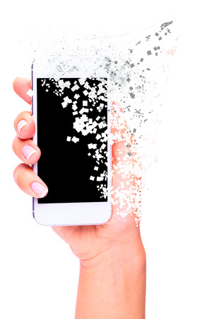 disintegration: Hand holding White Smartphone with blank screen disintegration on white background