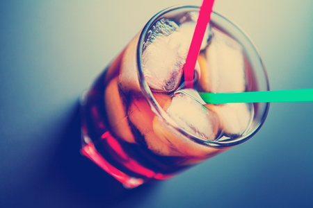 carbonation: soft drinks Cola glass with ice cubes on a white background
