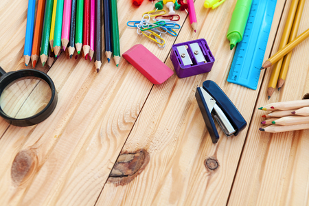 school supplies isolated on a wooden background Stock Photo