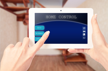 temperature controller: Remote home control system on a digital tablet or phone Stock Photo