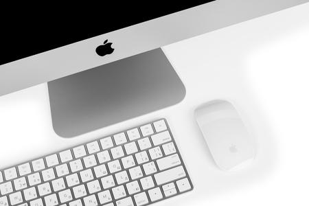 retina display: UKRAINE, RIVNE, December 2, 2016. Apple Computer iMac 27 retina display 5K keyboard and magic mouse on black table.