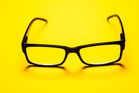 black eye glasses isolated on yellow background Banque d'images - 138181351