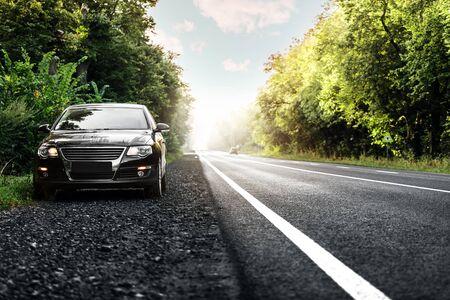 black car on asphalt road Banque d'images - 135491865