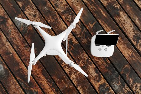 Drone quadcopter on the old wooden background Banque d'images - 135491944