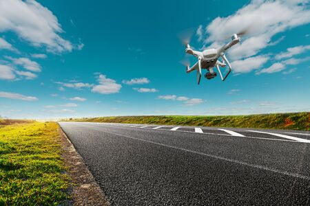 drone and transportation. drone with camera controls highway road conditions Banque d'images - 135493185