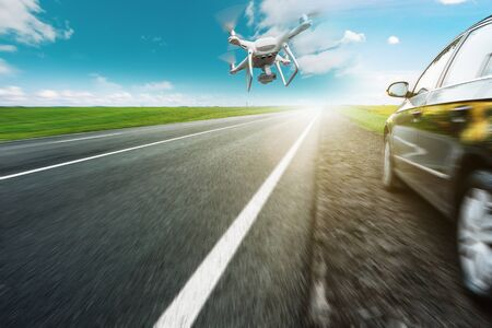 drone and transportation. drone with camera controls highway road conditions Banque d'images - 137370254