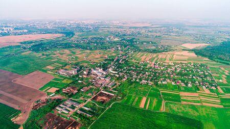 European village, river, forest. Aerial view.