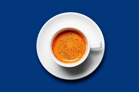 Black coffee in a cup on a blue background