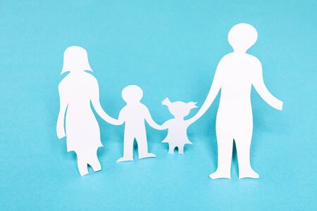 Family paper chain cutout holding hands on the blue background