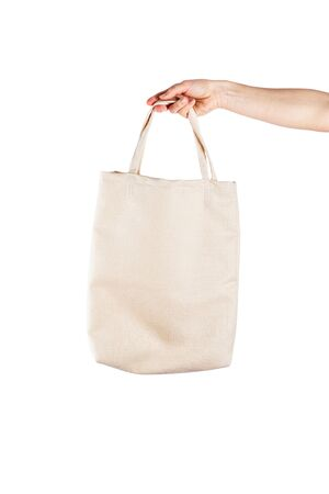 Woman with cotton eco bag over white backgound. Ecology or environment protection concept. White eco bag for mock up Banque d'images - 137389962