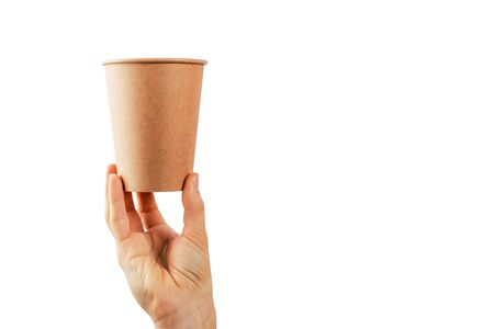 Mockup of woman hand holding a Coffee paper cup isolated on white background. Banque d'images - 137371213