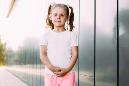 little girl in white t-shirt. space for your logo or design. Mockup for print