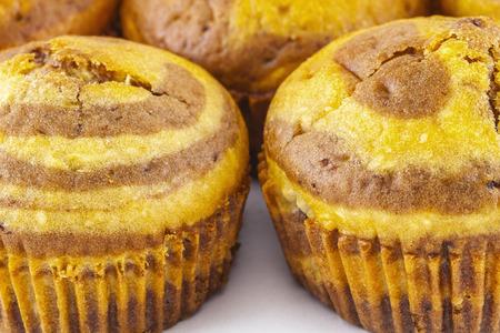 medium close up: Close up shot of a medium group of muffins on white