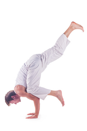 eka: Man practicing yoga against a white background Stock Photo