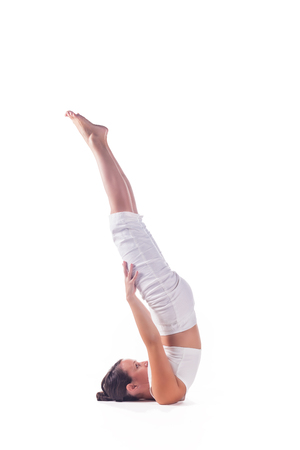 Woman practicing yoga against white background
