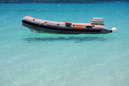 dingy: Boat rescue moored in clear water