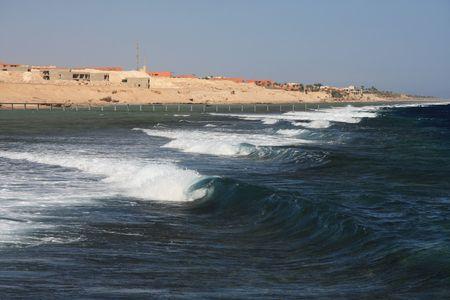 sharm el sheik: Wave breaking on coral reef - Sharm El Sheik - Egypt Stock Photo