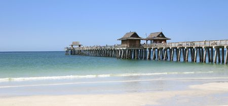 The long pier of caribbean beach of Naples in Florida - USA Stock Photo