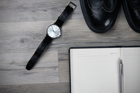 brogue: Watch with brogue and notebook on the textures . Background